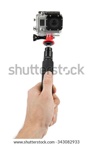 taking selfie - hand hold monopod with action camera - stock photo