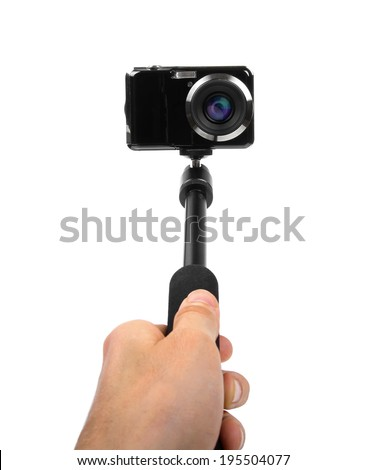 taking selfie - hand hold monopod with photo camera - stock photo