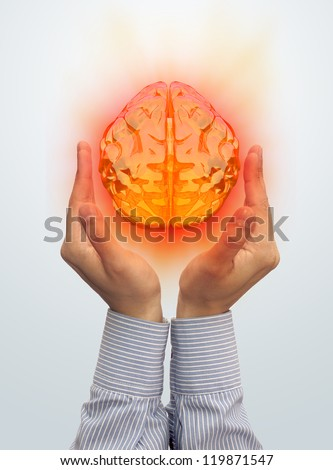 Taking the brain in the hand - stock photo