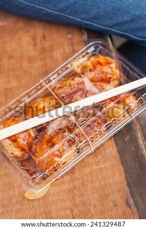 takoyaki or ball shaped pancakes with octopus - stock photo