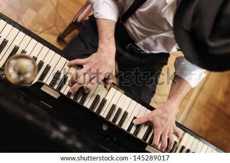 Talent and virtuosity. Top view of handsome young men playing piano - stock photo