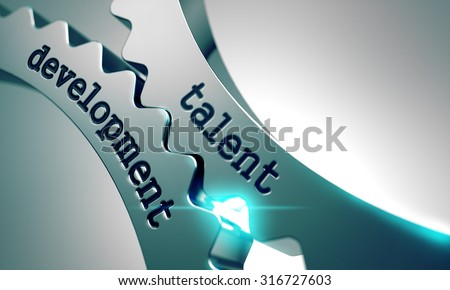 Talent Development on the Mechanism of Metal Cogwheels. - stock photo