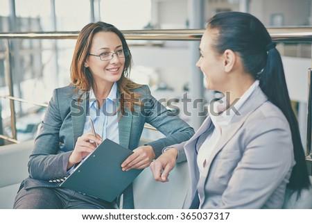 Talk of businesswomen - stock photo