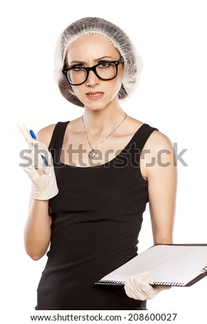 Talking angry woman with a pen, protective cap and gloves - stock photo