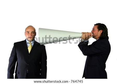 Talking down the megaphone - stock photo