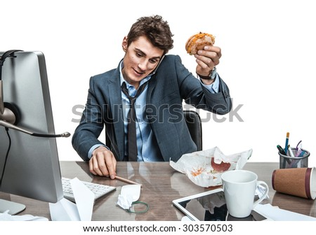 Talking on the phone and looking down young business man at working place, sloth and laziness concept - stock photo
