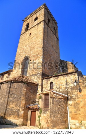 Tall belfry of an old church in Orange, France - stock photo