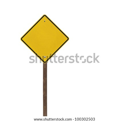 Tall blank isolated caution sign on a wooden post. - stock photo