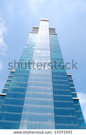 Tall Building against a blue sky - stock photo