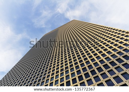 tall building in tel-aviv minutes before sunset - stock photo
