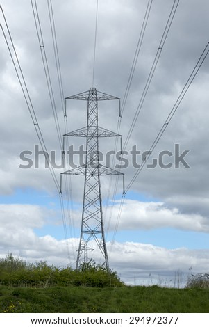 Tall electrical transmission towers at hydro-elecctric dam - stock photo