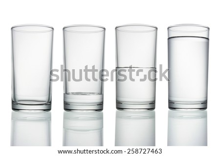 tall empty, half and full glass of water isolated on white with clipping path included - stock photo