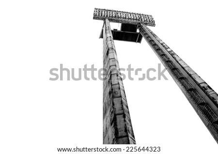 Tall floodlight at an outdoor sports venue - stock photo