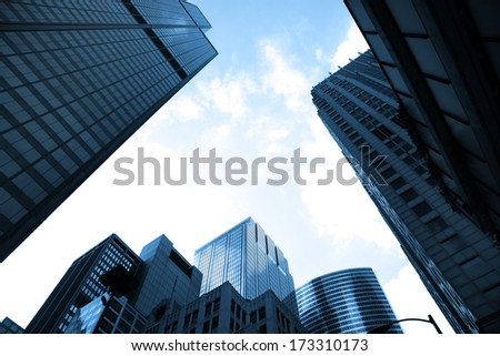 Tall glass buildings - stock photo
