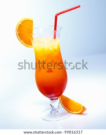 Tall glass of iced fresh fruit orange cocktail with a straw against a pale blue background in a tropical vacation concept - stock photo