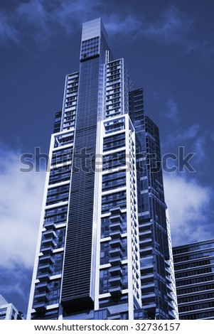 Tall High Rise Urban Office Building In Sydney, Australia - Blue Toning - stock photo