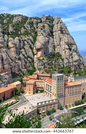 Tall mountains surrounding the monastery of Santa Maria de Montserrat (Montserrat Monastery) in Catalonia, Spain - stock photo
