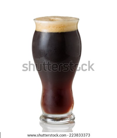 Tall shapely glass filled with dark European beer on white with reflection - stock photo