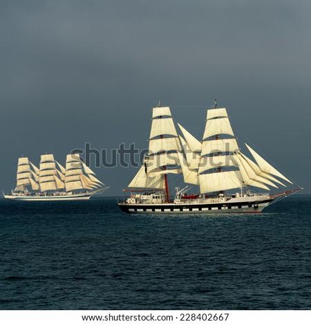 Tall ship regatta. Series of ships and yachts - stock photo