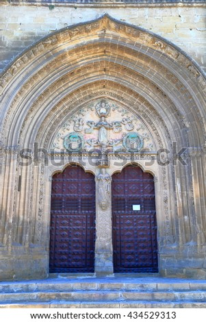 Tall stone arches above twin doors of San Pablo church in Ubeda, Andalusia, Spain - stock photo