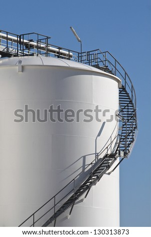 Tall storage tank - stock photo