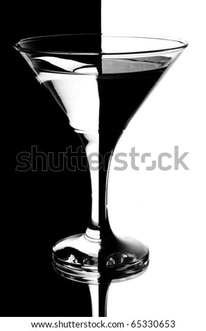 tall wine glass for a martini on a black background - stock photo