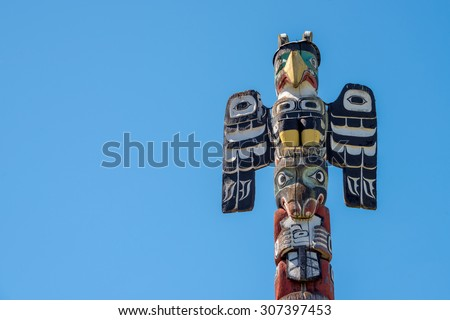 Tall wood carved Totem pole on Vancouver Island, British Columbia, Canada.  - stock photo