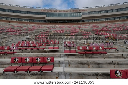 TALLAHASSEE, FLORIDA - DECEMBER 6: Seminole seats scattered around Doak Campbell Stadium on the campus of Florida State University on December 6, 2014 in Tallahassee, Florida - stock photo