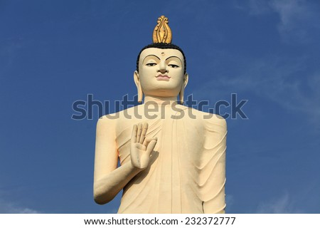Tallest Statue of Buddha with golden statues in Sri Lanka - stock photo