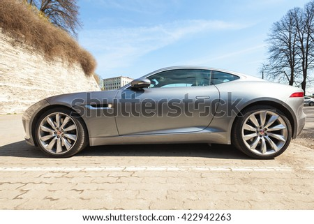 Tallinn, Estonia - May 2, 2016: Gray metallic Jaguar F-Type coupe S, side view. Two-seat sports car, based on platform of the XK convertible, manufactured by British manufacturer Jaguar Cars from 2013 - stock photo