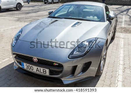 Tallinn, Estonia - May 2, 2016: Jaguar F-Type coupe, closeup photo. Two-seat sports car, based on a platform of the XK convertible, manufactured by British manufacturer Jaguar Cars from 2013 - stock photo