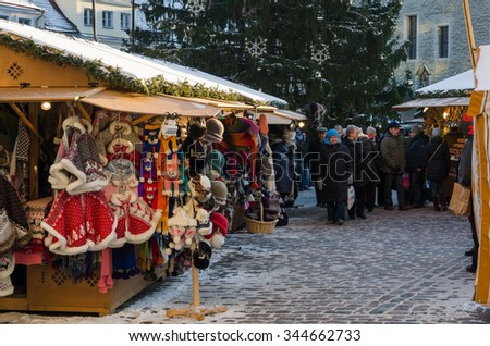 TALLINN, ESTONIA - NOVEMBER 30: People enjoy Christmas market in Tallinn on November 30, 2014 in Tallinn , Estonia. It is Estonia oldest Christmas Market with a very long history dating back to 1441 - stock photo