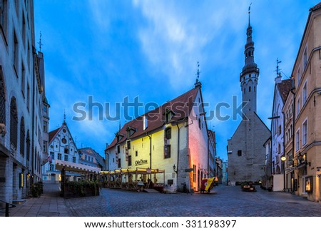 TALLINN, ESTONIA - OCTOBER 7, 2013: Wide angle view of the Old Town in the Estonian capital city Tallinn at dawn. The Old Town in Tallinn is a UNESCO World Heritage Site. - stock photo
