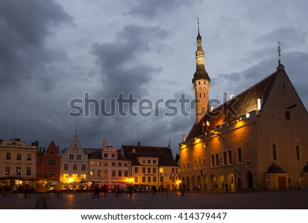 TALLINN - SEPTEMBER 10: Buildings of Town Hall Square in the night on September 10, 2013, TALLINN, ESTONIA. Old Town is listed in the UNESCO World Heritage List - stock photo