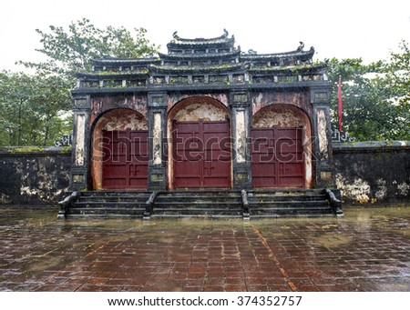 Tam Quan triple Gate at the Tomb of Minh Mang, Vietnam on a wet, rainy day - stock photo