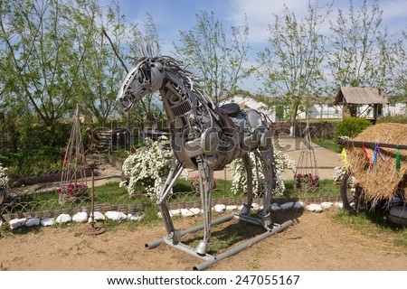 """TAMAN, RUSSIA-7 MAY,2014:The sculpture of a horse from metal parts in ethnographic village """"Ataman"""" a large museum in Russia. - stock photo"""