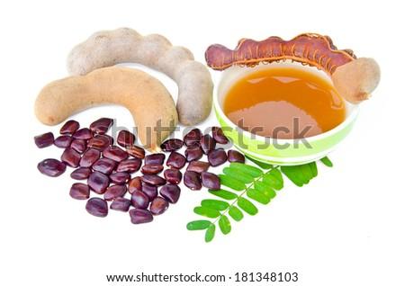 Tamarind and tamarind juice on white background - stock photo