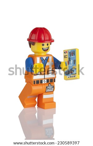 Tambov, Russian Federation - May 16, 2014 LEGO Hard Hat Emmet minifigure with instructions booklet on white background. LEGO Movie series. Studio shot.  - stock photo