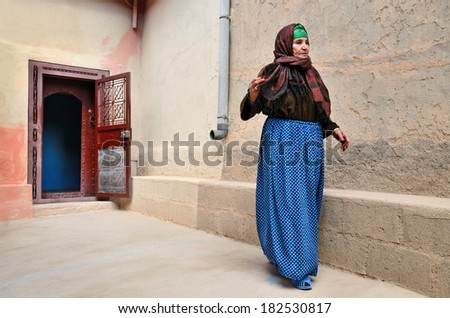 Tamnougalt, Morocco - March 12, 2014: Senior indigenous berber woman in front of her house. - stock photo