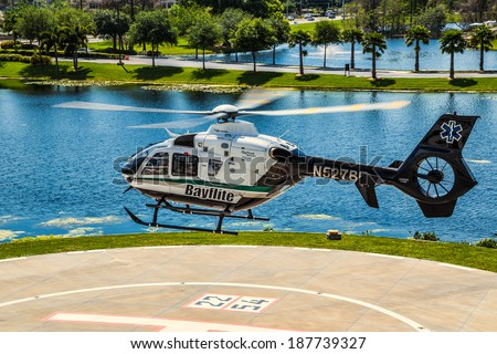 Tampa, Florida April 4th, 2014 Bayflite Trauma Rescue Helicopter Lifting off to respond to an accident scene in Tampa Florida. - stock photo