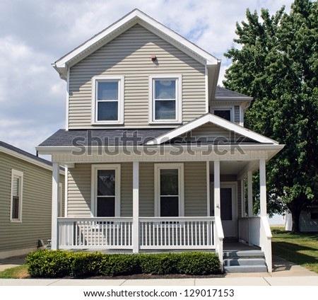 Tan House with Porch - stock photo