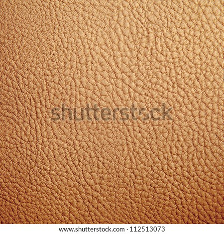 Tan leather texture background. Close-up photo - stock photo