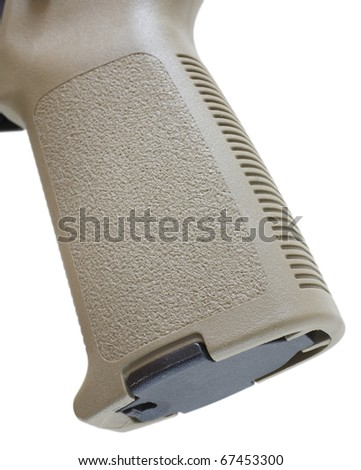 tan pistol grip that is found on an assault weapon - stock photo