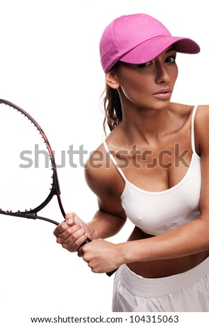 tan woman in white sportswear and and pink cap holding tennis racquet - stock photo