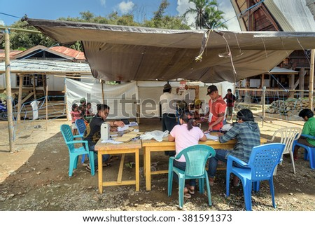 Tana Toraja, Indonesia - Dec 09, 2015: Legislative elections held in Lempo village. unidentified Indonesian people count voices.  South Sulawesi - stock photo