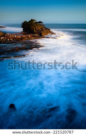 Tanah Lot is a rock formation off the Indonesian island of Bali - stock photo
