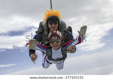 Tandem jump. Flying in a free fall. - stock photo