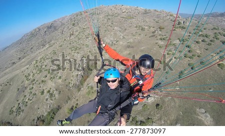 Tandem paragliding, extreme tourist attraction - stock photo