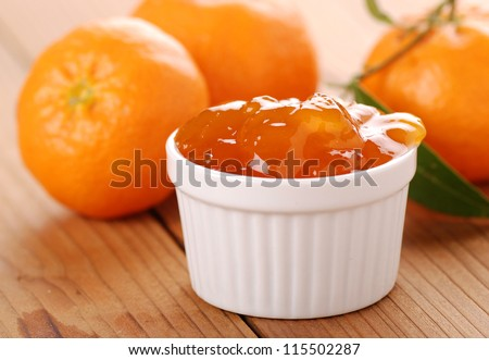 tangerine jam in a jars with fresh fruits - stock photo