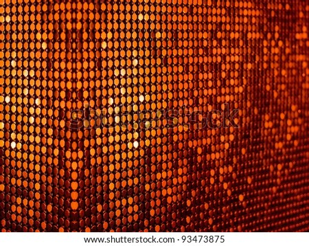 Tangerine orange sequins textile background. Ideal for disco, party, carnival or christmas design. More of this motif & more textile in my port - stock photo